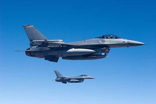Two F-16's in formation.
